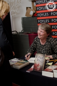 Lucienne Boyce at a booksigning table in Foyles with Bloodie Bones