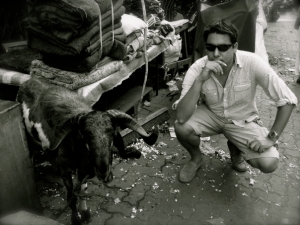 Photo of Charlie Raymond with a goat